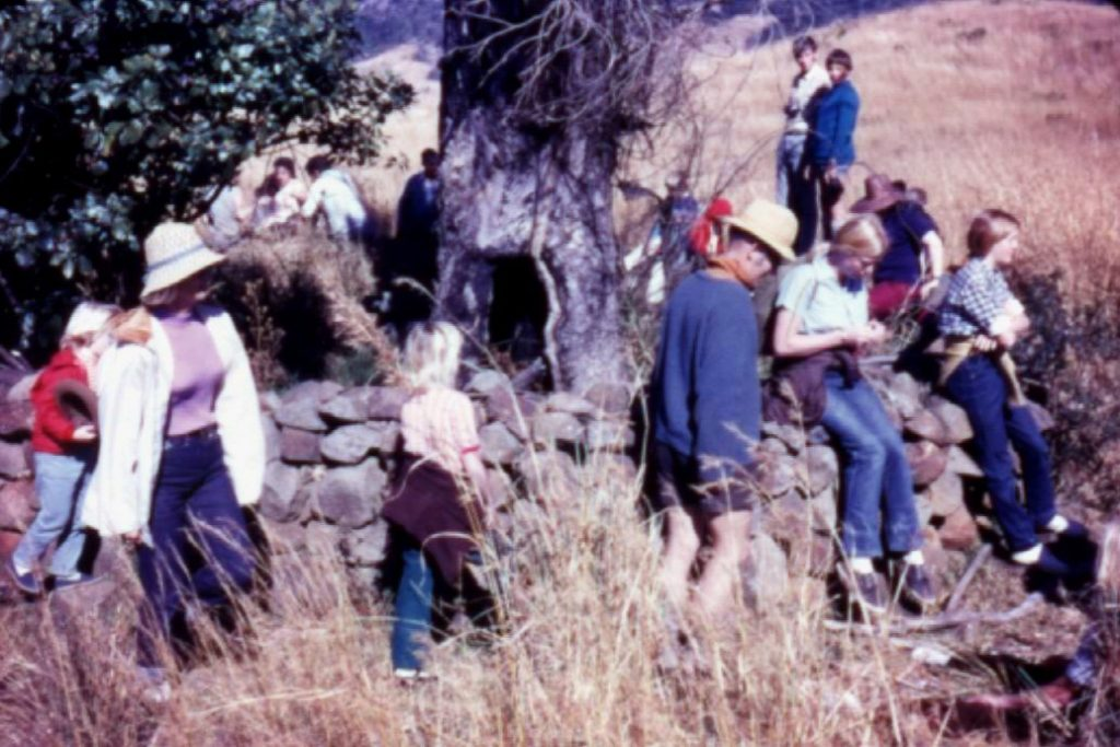 Climbers stop at Campbell and Lloyd's grave, Hlobane, 1973