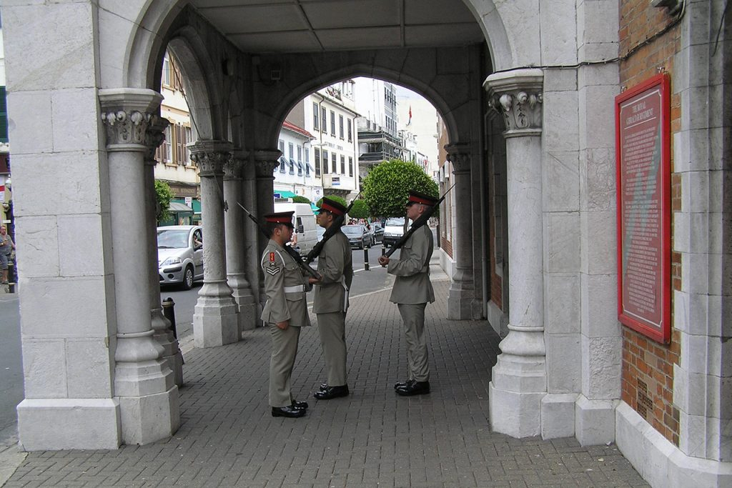 Guards on duty near Royal Gibraltar Regiment plaque