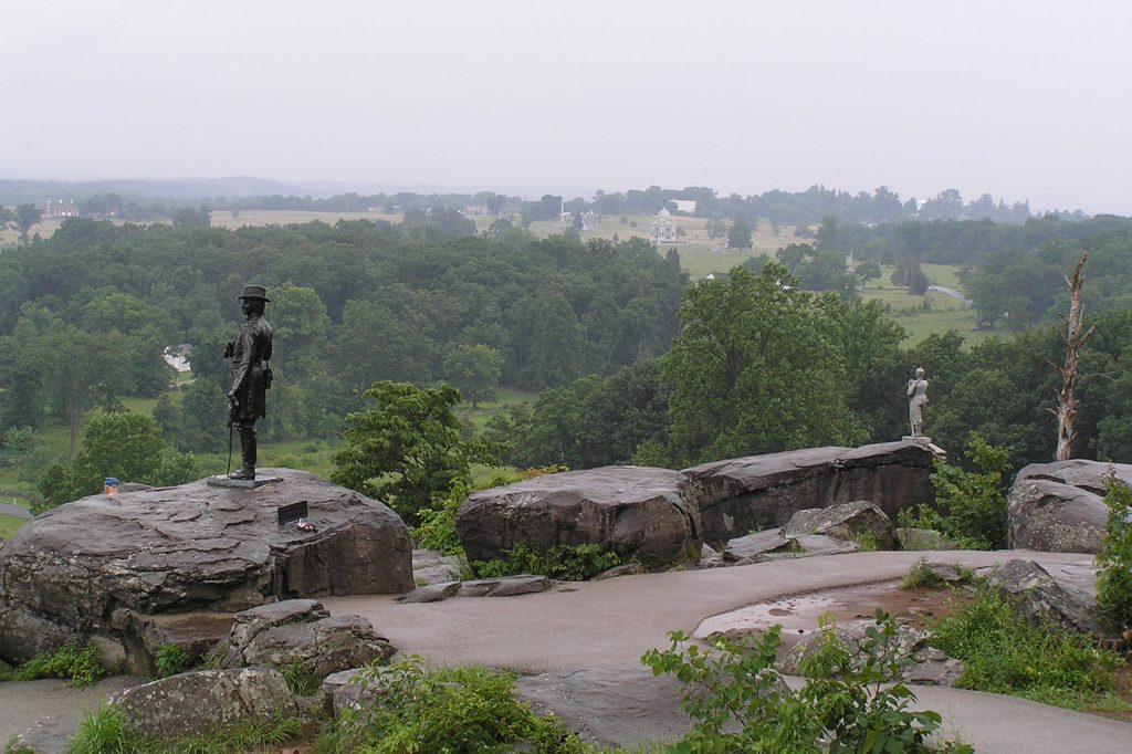 General Warren's Monument, on top of Little Round Top, overlooks the Devil's Den, the Valley of Death, the Wheatfield and the Peach orchard (See video clip)